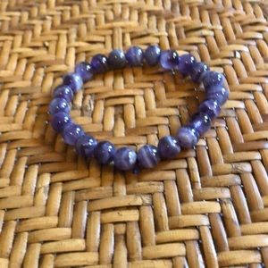 Chakra purple tigers eye bracelet can bring good things your way. Very RARE.